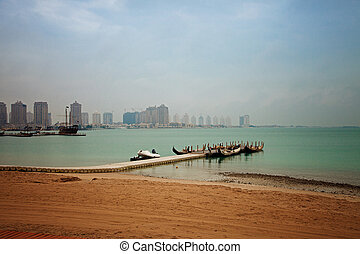 Small boat jetty by the beach in Doha, Qatar