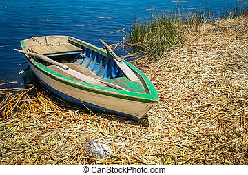 Small boat on a Titicaca lake,