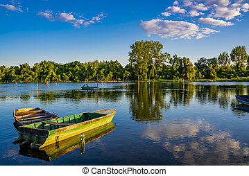 Small boat on the calm lake