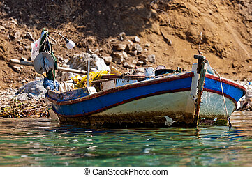 Small boat on the shore