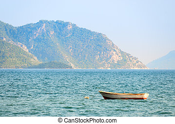small boat on the waves of the sea