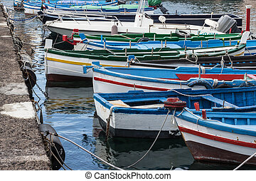 Small boats anchored in Sicily, Italy.