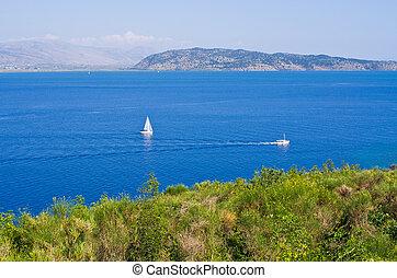 Small boats near the shore of Corfu island, Greece
