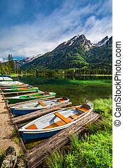 Small boats on the lake Hintersee in the Alps