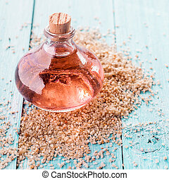 Small Bottle of Essential Aromatic Oil with Grains