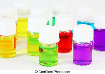Small bottles of different colored aromatic oils; yellow, green, red, purple