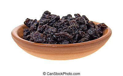 Small serving of currants in clay bowl on a white background.