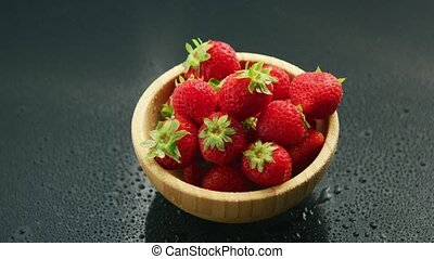 Small bowl of fresh red strawberry - From above shot of...