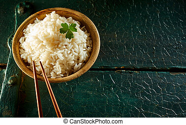 Small Bowl of White Rice with Chopsticks on Table