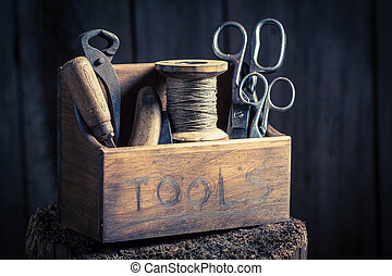 Small box of tools in wooden workshop