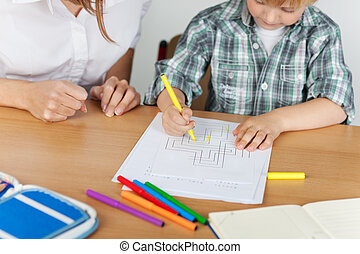 Small boy coloring - Small boy is coloring during...