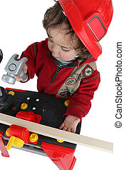 Small boy dressed as builder