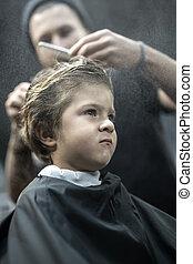 Small boy in barbershop