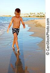 small boy on the beach of sea