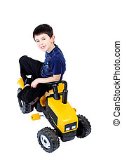 small boy on the yellow tractor isolated on white background