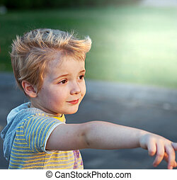 Small boy - Young boy playing in park