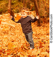 Small boy running in forest