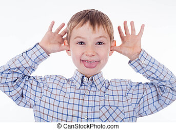 Small boy - A small boy is grimacing on the white background...