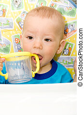 small boy - the small boy to sit still with cup
