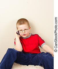 Small Boy - the small boy in glasses uses mobile phone