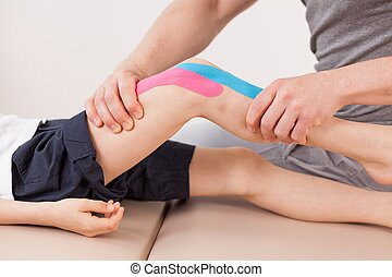 Small boy with kinesio tape - Close up of small boy with...