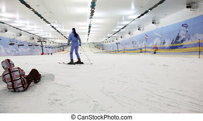 small boy with snowboard prepares for training in sport...