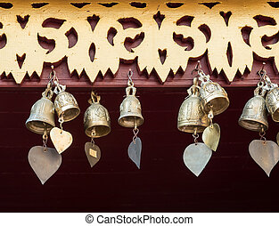 Small brass bell with the heart shape tail. - Small brass...