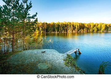 Small bridge on a lake in autumn