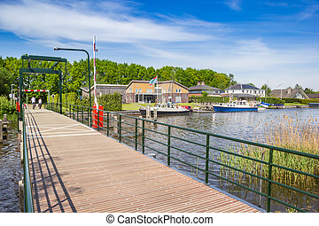 Small bridge over a canal at the Zuidlaardermeer lake in Groningen, Netherlands