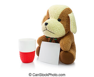 Small brown puppy with red mug and card isolated on white background.