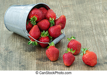 Small bucket with delicious fresh strawberries