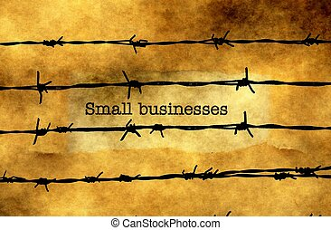 Small business concept against barbwire
