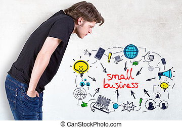 Small business concept - Side view of young man bending to...