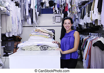 happy owner of a dry cleaning service - small business: ...