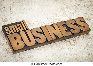small business text in vintage letterpress wood type on a ceramic tile background