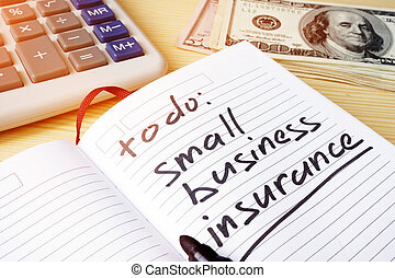 Small business insurance written in a note pad.