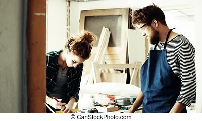 Small business of a young couple. A man and woman worker in...