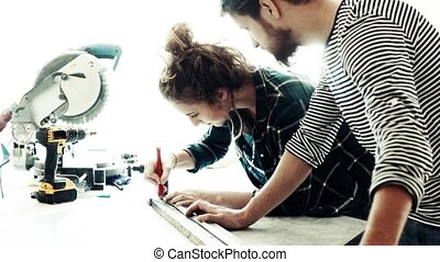 Small business of a young couple. Man and woman worker in...