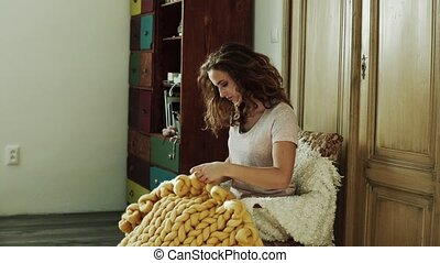 Small business of a young woman. Young woman hand-knitting a...