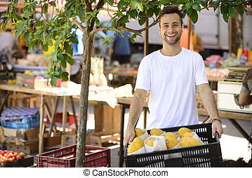 Small business owner selling organic fruits and vegetables...