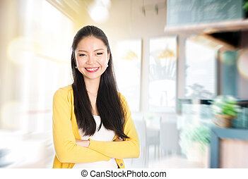 Small business owner - Asian female shop owner arms crossed...