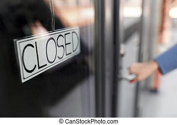 hand trying to open closed office door