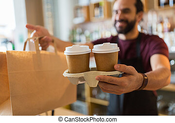 man or bartender serving customer at coffee shop - small ...