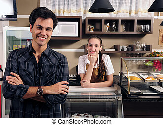 owner of a cafe and waitress - small business portrait:...