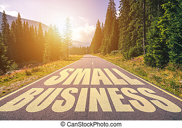 Small business text written on road in the mountains