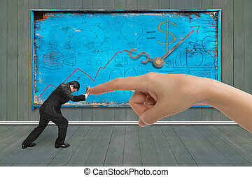 Small businessman pushing against big hand forefinger