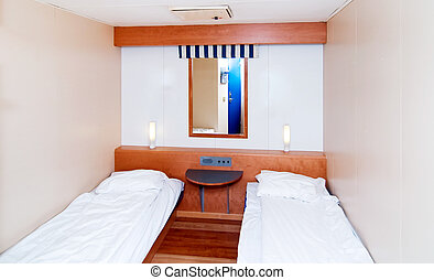 A very small cabin room on a cruise ship