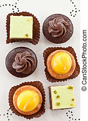 Small cakes - Variety of small cakes with chocolate and...