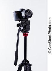 Small camera tripod on white background.