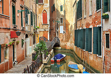 Small canal among buildings. Venice, Italy.
